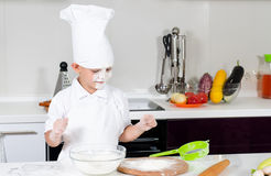 Cute little boy chef in the kitchen Stock Image
