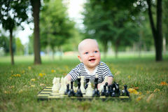 Cute little boy with chess in summer park Royalty Free Stock Photography