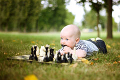 Cute little boy with chess in summer park Royalty Free Stock Photos