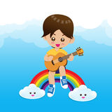 Cute Little boy child playing a music guitar on rainbow Stock Photos