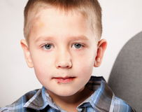 Cute little boy with a chocolate on the face Stock Photos