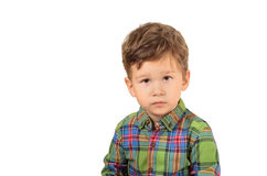 Cute little boy. Closeup portrait of cute little boy in checkered shirt on white background Royalty Free Stock Image