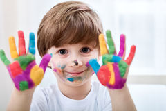Cute little boy with colored hands Royalty Free Stock Photo