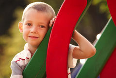 Cute little boy in a colorful kids playground royalty free stock image