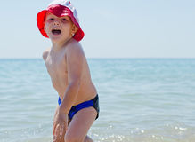 Cute little boy romping in the sea Royalty Free Stock Photos