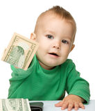 Cute little boy is counting money. Isolated over white Stock Photos