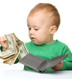 Cute little boy is counting money. Isolated over white Stock Images