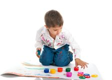 Cute little boy covered in bright paint Royalty Free Stock Images