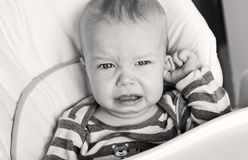 Cute little boy crying holding his ear Royalty Free Stock Photography