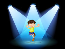 A cute little boy dancing in the stage Stock Images