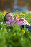 Cute little boy in a dandelion field Stock Images