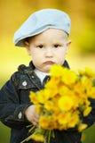 Cute little boy with dandelions Stock Image