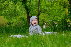 Cute little boy with dandelions Royalty Free Stock Photography