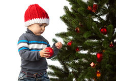 Cute little boy decorating Christmas tree Royalty Free Stock Photos