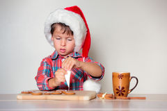 Cute little boy decorating the gingerbread cookies Royalty Free Stock Images