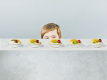 Cute little boy with delicious cake Stock Photo