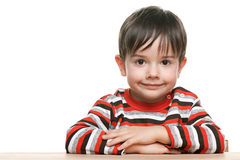 Cute little boy at the desk stock photo