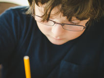 Boy doing his homework Stock Images