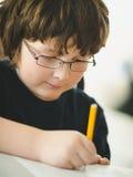 Boy doing his homework Stock Photos