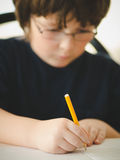 Boy doing his homework Royalty Free Stock Photography