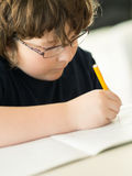 Boy doing his homework Royalty Free Stock Image