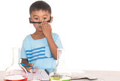 Cute little boy doing science experiment Royalty Free Stock Photography