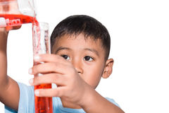 Cute little boy doing science experiment Royalty Free Stock Photos