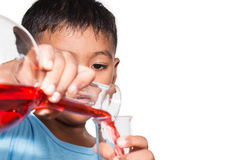 Cute little boy  doing science experiment Royalty Free Stock Images