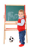 Cute little boy drawing on chalkboard Royalty Free Stock Images