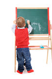 Cute little boy drawing on chalkboard Stock Photo