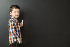 Cute little boy drawing on the chalkboard Royalty Free Stock Image