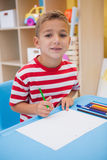 Cute little boy drawing at desk Stock Photo