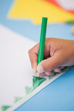 Cute little boy drawing at desk Stock Photography