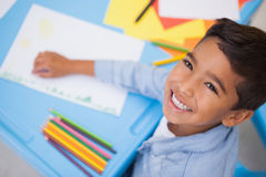 Cute little boy drawing at desk Stock Image