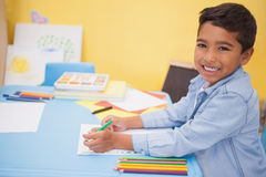Cute little boy drawing at desk Royalty Free Stock Image