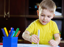 Cute little boy drawing with felt-tip pen Royalty Free Stock Images