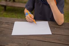 Cute little boy drawing at home. Children`s creativity. Creative kid painting at preschool. Development and education concept.Happ. Y kid drawing with colorful stock photo
