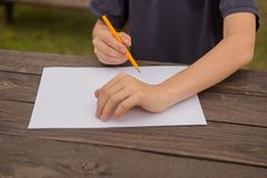 Cute little boy drawing at home. Children`s creativity. Creative kid painting at preschool. Development and education concept.Happ. Y kid drawing with colorful stock image