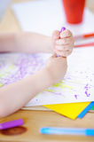 Cute little boy drawing and painting with colorful markers pens at kindergarten. Creative kid painting at playschool. Development toys for preschooler children Stock Photos