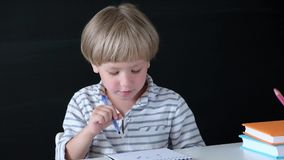 Cute little boy drawing at the table. Child from elementary school. Education concept. Back to school. stock video