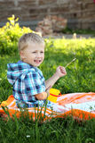 Cute little boy draws in summer park Royalty Free Stock Images