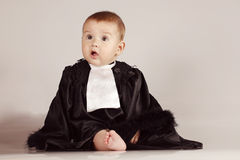 Cute little boy dressed in robe having fun and smiling on isolated background Royalty Free Stock Images