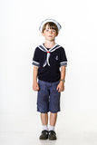 Cute little boy dressed in sailor suit Stock Image