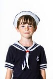 Cute little boy dressed in sailor suit Stock Photos