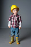 Cute little boy dresses up and plays Royalty Free Stock Images