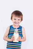 Cute little boy, drinking milk, holding glass of milk, mustaches Stock Image