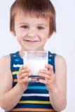 Cute little boy, drinking milk, holding glass of milk, mustaches Stock Image