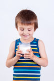 Cute little boy, drinking milk, holding glass of milk, mustaches Stock Photo