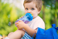 Cute little boy drinking water Stock Photos
