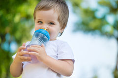 Cute little boy drinking water Stock Photography